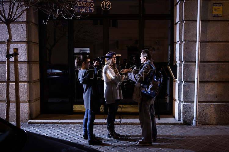 Madrid, Spain, February 12, 2015. A member of the left wing [party] Podemos answers the questions to two journalism students after their weekly meeting in Salamanca's neighbourhood in Madrid.