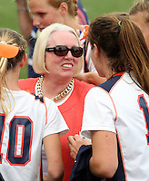 The University of Virginia women's lacrosse players surround Sharon Donnelly, the mother of slain teamate Yeardley Love, after the 14-12 victory over Towson during the 1st round of NCAA play Sunday May 16, 2010 at Klockner Stadium in Charlottesville, Va. The Cavaliers rallied in the last four minutes to beat Towson and reach the quarter finals of the NCAA tournament. Love's body was found May 3, and Virginia men's lacrosse player George Huguely is charged with murder. Photo/Andrew Shurtleff..