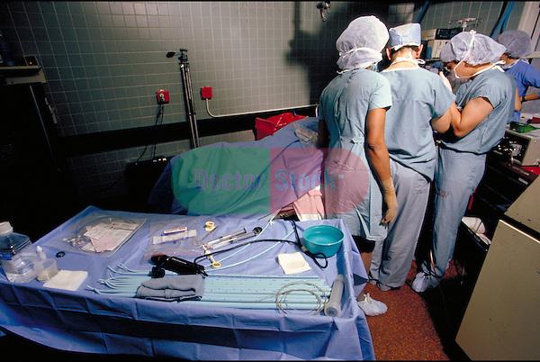 surgeon and nurses around operating table