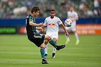 CARSON, CA - APRIL 25: Jorge Villafana #19 of the Los Angeles Galaxy traps a ball during a game between New York Red Bulls and Los Angeles Galaxy at Dignity Health Sports Park on April 25, 2021 in Carson, California.