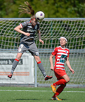 20140419 - ANTWERPEN , BELGIUM : Standard's Julie Biesmans (left) pictured with Antwerp Stephanie Suenens during the soccer match between the women teams of RAFC Antwerp Ladies  and Standard Femina  , on the 24th matchday of the BeNeleague competition on Saturday 19 April 2014 in Deurne .  PHOTO DAVID CATRY