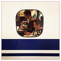 Passengers on the Shinkansen, bullet train, in Tokyo.