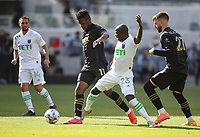 LOS ANGELES, CA - APRIL 17: José Cifuentes #11 of LAFC fights with  Kekuta Manneh #23 of Austin FC for a loose ball during a game between Austin FC and Los Angeles FC at Banc of California Stadium on April 17, 2021 in Los Angeles, California.