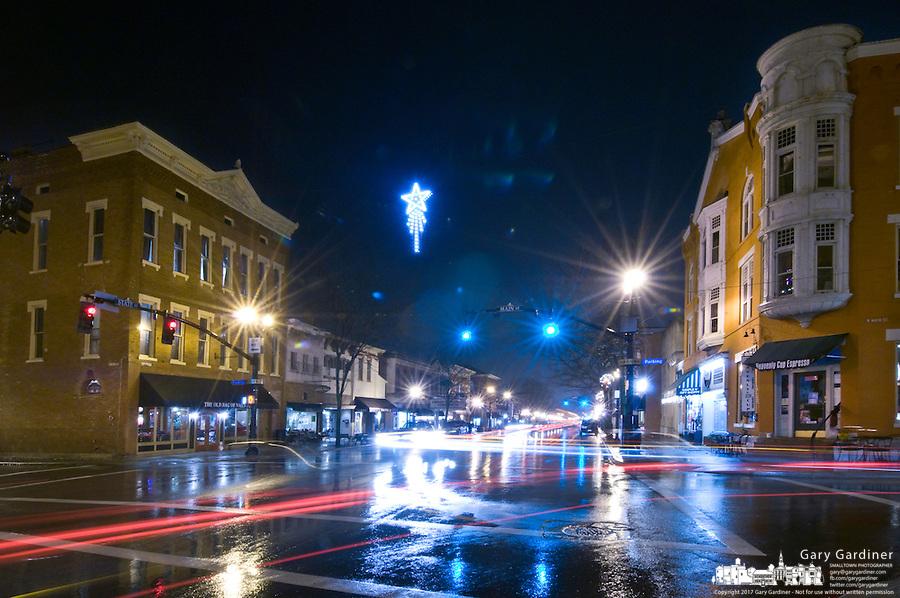 Light rain falls on a cool winter night in Uptown Westerville, Ohio. Photo Copyright Gary Gardiner.