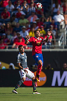 Orlando, Florida - Saturday, June 04, 2016: Costa Rican defender Ronald Matarrita (22) rises up to head the ball in front of Paraguayan forward Dario Lezcano (19) during a Group A Copa America Centenario match between Costa Rica and Paraguay at Camping World Stadium.