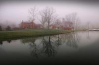 Everal Barn and homestead farm in an early morning fog.