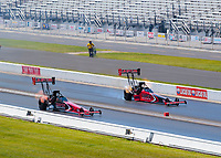 Jul 12, 2020; Clermont, Indiana, USA; NHRA top fuel driver Billy Torrence (near) races alongside son Steve Torrence during the E3 Spark Plugs Nationals at Lucas Oil Raceway. This is the first race back for NHRA since the start of the COVID-19 global pandemic. Mandatory Credit: Mark J. Rebilas-USA TODAY Sports
