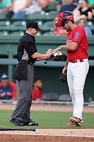 Umpire Jose Lozada works a game between the Hickory Crawdads and the Greenville Drive on Friday, June 18, 2021, at Fluor Field at the West End in Greenville, South Carolina. The player is Kole Cottam (9). (Tom Priddy/Four Seam Images)