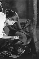 Sudan. Southern part. Bahr El Ghazal. Marial Lou. Dinka tribe area. Hospital. A nurse (an expatriate) from the ngo (non governmental organisation) MSF Switzerland ( Médecins Sans Frontières. Doctors without Borders) checks the health of a patient lying in bed. © 1998 Didier Ruef
