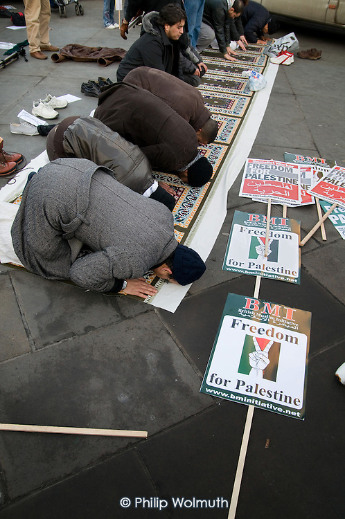 Muslims pray during a rally in Trafalgar Square following a march called by the Palestine Solidarity Campaign, Stop the War Coalition, British Muslim Initiative and other organisations, to protest at the Israeli bombing of Gaza.