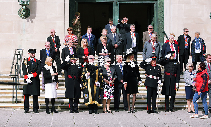 Pictured: Councillor Philip Downing (4th LEFT), H.M. Lord Lieutenant of West Glamorgan D Byron Lewis (8th L) and other dignitaries take a salute outside the Guild Hall, Swansea.  Friday 15 September 2017<br />Re: Soldiers from the Welsh Guards have exercised their freedom to march through the streets of Swansea in Wales, UK.<br />The Welsh warriors paraded with bayonets-fixed from the city centre to the Brangwyn Hall, where the Lord Mayor of Swansea took a salute.