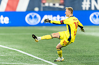 FOXBOROUGH, MA - AUGUST 29: Ryan Meara #18 of New York Red Bulls clears the ball during a game between New York Red Bulls and New England Revolution at Gillette Stadium on August 29, 2020 in Foxborough, Massachusetts.