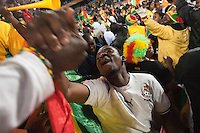 A Ghana fan cheers and shakes hands with another fan after Ghana scoring a goal during their first round match of against Serbia at Loftus Versfeld Stadium in Pretoria, South Africa on Saturday, June 12, 2010.  Ghana defeated Serbia on a penalty kick goal 1-0.
