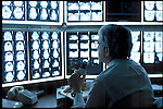 doctor reviewing CAT scans and dictating