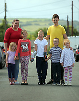 Pictured: Alan Gifford (C) with his mum Hannah Jones (TOP L), older brother Jordan Heard (TOP R) and brothers and sisters, Lacey, Isabelle, Liam and Madison Carey. Friday 18 August 2017<br /> Re: 11 year old Alan Gifford who has two prosthetic arms, Loughor near Swansea, Wales, UK.