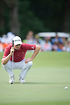 Justin Rose of England ponders his next shot during Hong Kong Open golf tournament at the Fanling golf course on 25 October 2015 in Hong Kong, China. Photo by Aitor Alcade / Power Sport Images