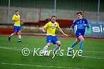 Jamie McIntyre of Classic in possession as he is been watched by Luke O'Connell of Dingle Bay Rovers in the Denny KDL Challenge Cup