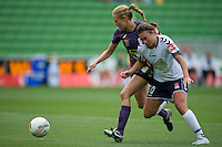 MELBOURNE, AUSTRALIA - DECEMBER 18: Alexandra NILSSON of the Glory and Jodie TAYLOR of the Victory compete for the ball during the round 7 W-League match between the Melbourne Victory and the Perth Glory at AAMI Park on December 18, 2010 in Melbourne, Australia. (Photo Sydney Low / asteriskimages.com)