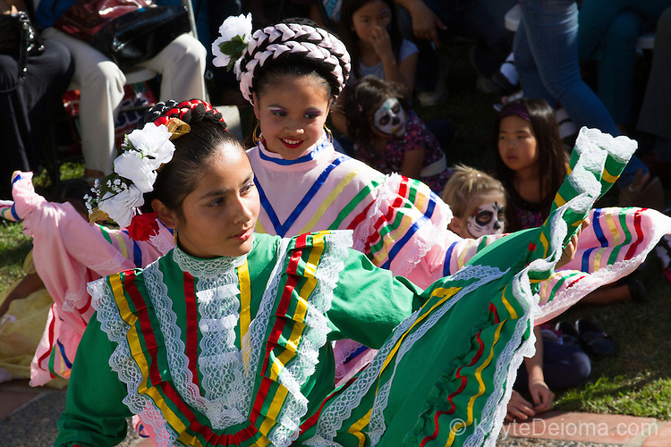 Teen Folklorico dancers perform at the Day of the Dead celebration at the Bowers Museum in Santa Ana, CA