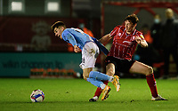 Manchester City U21's Ben Knight is fouled by Lincoln City's Conor McGrandles<br /> <br /> Photographer Chris Vaughan/CameraSport<br /> <br /> EFL Papa John's Trophy - Northern Section - Group E - Lincoln City v Manchester City U21 - Tuesday 17th November 2020 - LNER Stadium - Lincoln<br />  <br /> World Copyright © 2020 CameraSport. All rights reserved. 43 Linden Ave. Countesthorpe. Leicester. England. LE8 5PG - Tel: +44 (0) 116 277 4147 - admin@camerasport.com - www.camerasport.com