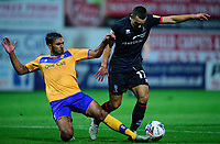 Lincoln City's Ramirez Howarth vies for possession with Mansfield Town's Malvind Benning<br /> <br /> Photographer Andrew Vaughan/CameraSport<br /> <br /> EFL Trophy Northern Section Group E - Mansfield Town v Lincoln City - Tuesday 6th October 2020 - Field Mill - Mansfield  <br />  <br /> World Copyright © 2020 CameraSport. All rights reserved. 43 Linden Ave. Countesthorpe. Leicester. England. LE8 5PG - Tel: +44 (0) 116 277 4147 - admin@camerasport.com - www.camerasport.com