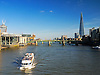 A view down the Thames to the east from the Millennium Bridge with a passenger boat heading towards us and a good view of the Shard and Tower Bridge in the distance. It's all in there.<br /> <br /> Stock Photo by Paddy Bergin