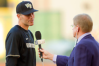 Wake Forest Demon Deacons head coach Tom Walter #32 is interviewed prior to the game against the LSU Tigers at Alex Box Stadium on February 18, 2011 in Baton Rouge, Louisiana.  The Tigers defeated the Demon Deacons 15-4.  Photo by Brian Westerholt / Four Seam Images