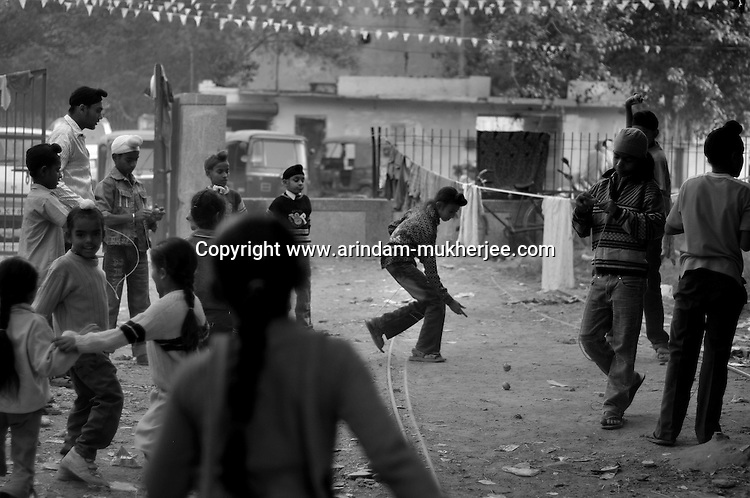 Children playing in a park at Tilak Vihar. Tilak Vihar in New Delhi is called the widow colony. Widows and children of Sikh who were killed in 1984 Sikh Genocide live here.  4000 Sikhs were killed in 72 hours alone in Delhi but no body till date got punished for such a human crime. Illiteracy, Drug addiction, child labour and immense poverty characterize the area. 25 years ago all the male family members above the age of  15 were killed and burnt living their uneducated widows and children to suffer even after 25 years. The present generation is jobless, alcoholic and lost their directions in life. November 2009. New Delhi, India, Arindam Mukherjee
