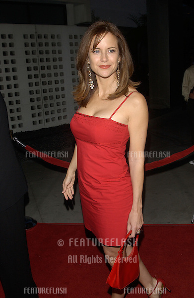 """Actress KELLY PRESTON at the Los Angeles premiere of husband John Travolta's new movie The Punisher..Kelly revealed that the dress she's wearing was bought """"off the rack"""" for $19.95 - however she said her shoes cost """"about 50 times that much!"""".April 12, 2004"""
