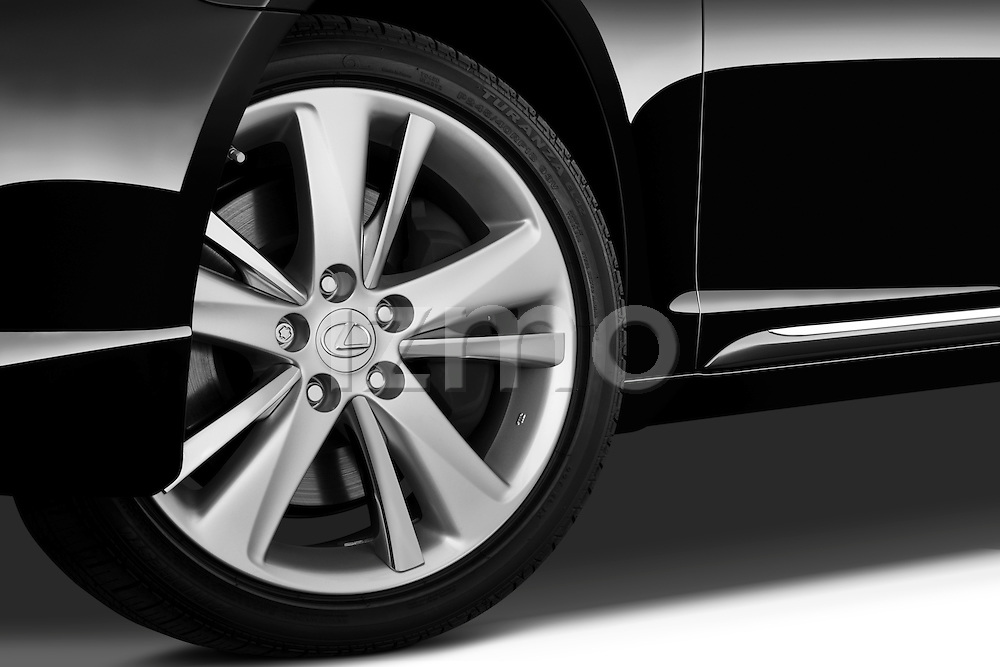 Tire and wheel close up detail view of a 2010 Lexus GS Hybrid