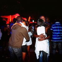 Young couples dance together at Luanda club Esplanada 10 on a Saturday night.  .