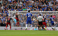 Pictured: Angel Rangel of Swansea (2nd L) heads the ball away from a Chelsea cross. Saturday 13 September 2014<br /> Re: Premier League Chelsea FC v Swansea City FC at Stamford Bridge, London, UK.