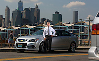 New York, July 10, 2014. Australian Consul-General in New York, Nick Minchin pictured with an Australian-made Chevrolet SS car that he uses for consulate business. photo by Trevor Collens.