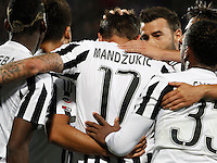 Calcio, Serie A: Fiorentina vs Juventus. Firenze, stadio Artemio Franchi, 24 aprile 2016.<br /> Juventus' Mario Mandzukic, center, back to camera, is hugged by teammates after scoring during the Italian Serie A football match between Fiorentina and Juventus at Florence's Artemio Franchi stadium, 24 April 2016. <br /> UPDATE IMAGES PRESS/Isabella Bonotto