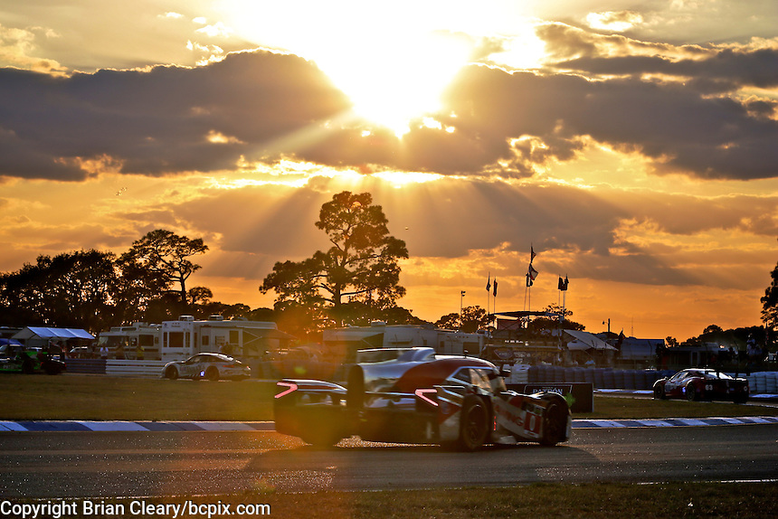 The #0 DeltaWing racer drives under the setting sun during the 12 Hours of Sebring, Sebring International Raceway, Sebring, FL, March 2014.  (Photo by Brian Cleary/www.bcpix.com)