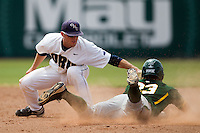Oral Roberts Golden Eagles shortstop Nate Goro #16 attempts to tag our Baylor baserunner Dan Evatt #23 during the NCAA Regional baseball game against Baylor University on June 3, 2012 at Baylor Ball Park in Waco, Texas. Baylor defeated Oral Roberts 5-2. (Andrew Woolley/Four Seam Images)