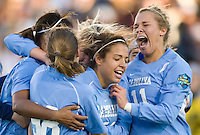 North Carolina Tar Heels forward Casey Nogueira (54) is mobbed by teammates at the finale whistle. The North Carolina Tar Heels defeated the Notre Dame Fighting Irish 2-1 during the finals of the NCAA Women's College Cup at Wakemed Soccer Park in Cary, NC, on December 7, 2008. Photo by Howard C. Smith/isiphotos.com