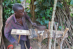Man Using Grinder For Nuts And Fruits