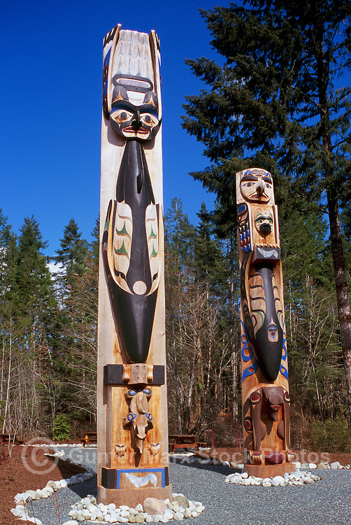 Two Nuu-chah-nulth Style Totem Poles on the Tseshaht First Nation Reserve near Port Alberni, on Vancouver Island, British Columbia, Canada
