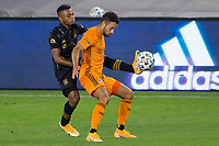 CARSON, CA - OCTOBER 28: Darwin Ceren #24 of the Houston Dynamo battles with Jose Cifuentes #11 of the Los Angeles FC during a game between Houston Dynamo and Los Angeles FC at Banc of California Stadium on October 28, 2020 in Carson, California.