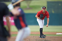 Kannapolis Intimidators relief pitcher Bennett Sousa (11) looks to his catcher for the sign against the Rome Braves at Kannapolis Intimidators Stadium on April 7, 2019 in Kannapolis, North Carolina. The Intimidators defeated the Braves 2-1. (Brian Westerholt/Four Seam Images)