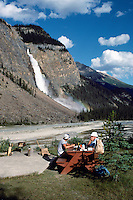 Yoho National Park, Canadian Rockies, BC, British Columbia, Canada - People having Picnic beside Yoho River at Base of Takakkaw Falls, Summer