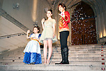 """July 18, 2012, Tokyo, Japan - (L-R) The child actress Tani Kanon, Lily Collins and the Japanese actor Daigo wave to the audience outside the St. Grace Cathedral at the Premier of """"Mirror Mirror"""" in Tokyo. The """"Mirror Mirror"""" film tells the story of an orphaned princess called Snow White (Lilly Collins) and her cruel stepmother the Queen (Julia Roberts) who plans to take over the kingdom. The Queen tries to get rid of Snow White by throwing the forest, but princess is rescued by a band of diminutive highway robbers, and with them she seeks to recover her kingdom. This film will be released from September 14 in Japan. (Photo by Rodrigo Reyes Marin/AFLO)"""