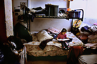 New Mexico, Navaho Indian Reservation.Families live in cramped hotels in town because they have no work on the reservations and no car to get back and forth to town where the work is.