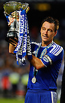 SO KON PO, HONG KONG - JULY 30: John Terry of Chelsea lifts the trophy after winning the Asia Trophy final match against Aston Villa at the Hong Kong Stadium on July 30, 2011 in So Kon Po, Hong Kong.  Photo by Victor Fraile / The Power of Sport Images