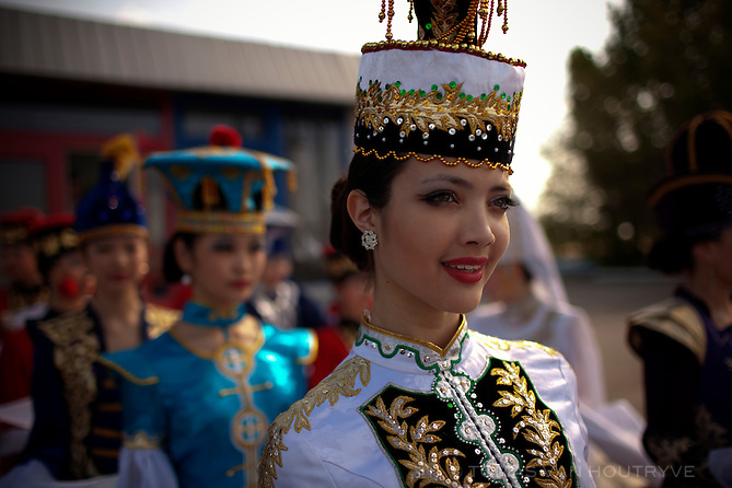 Young women from a modelling school prepare to greet the President of Vietnam before his arrival at the airport in Elista, Republic of Kalmykia, Russian Federation on May 10, 2010.