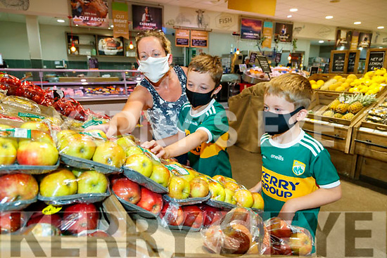 Helina Neligan with her sons Mark (10) and David (7) shopping in Garvey's Supervalu Tralee