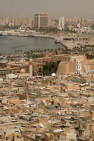 Tripoli, Libya - Medina and Harbor. Turkish Fort, Serai al-Hamra, center right. Corniche circles shoreline.