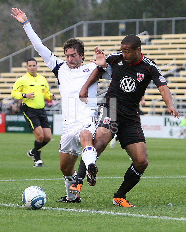 Ethan White#15 of D.C. United tangles with Corben Bone#19 of the Chicago Fire during a second round match of the Carolina Challenge on March 9 2011 at Blackbaud Stadium, in Charleston, South Carolina. D.C. United won 1-0.