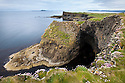 A sea cave known as the Boat Cave, Isle of Staffa, Inner Hebrides, Scotland, UK.